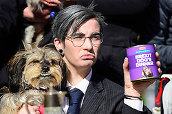"© Licensed to London News Pictures. 10/03/2019. LONDON, UK. A Jacob Ree-Mogg look-alike poses.  Pro-Remain owners bring their dogs to Victoria Park Gardens, next to the Houses of Parliament, for ""Brexit is a Dog's Dinner"", a protest to urge MPs to vote to ensure that a no-deal Brexit is avoided and to give the people of the UK a final say.  Next week, there will be a series of up to three votes in the House of Commons where MPs will vote on whether to accept Theresa May's Brexit deal.  Photo credit: Stephen Chung/LNP"