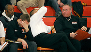 4 FEB. 2010 -- WEBSTER GROVES, Mo. -- Webster Groves head basketball coach Jay Blosson (center) and his assistant coaches react to the Statesmen's play during  the game Thursday, Feb. 4, 2010 between Webster Groves and Parkway West at Webster Groves High School. Photo (c) copyright by Sid Hastings.