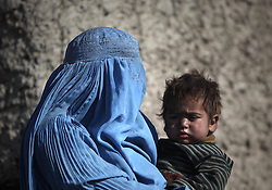 60887414<br /> An Afghan woman holds her son at a displaced camp in Kabul, Afghanistan, on Jan. 5, 2014. It is believed that some eight million Afghans live under the poverty line and survive on a daily income of one U.S. dollar per person., Kabul, Afghanistan, Saturday, 4th January 2014. Picture by  imago / i-Images<br /> UK ONLY