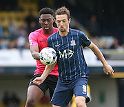 Southend player David Mooney shields the ball from Peterborough United player Ricardo Santos during the Sky Bet League 1 match between Southend United and Peterborough United at Roots Hall, Southend, England on 5 September 2015. Photo by Bennett Dean.