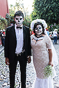 A couple dressed as the dapper skeleton and La Calavera Catrina costumes for Day of the Dead festival in San Miguel de Allende, Guanajuato, Mexico. The week-long celebration is a time when Mexicans welcome the dead back to earth for a visit and celebrate life.