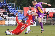 Ian Gayle blocks a Danny Wright shot during the Vanarama National League match between Welling United and Cheltenham Town at Park View Road, Welling, United Kingdom on 5 March 2016. Photo by Antony Thompson.