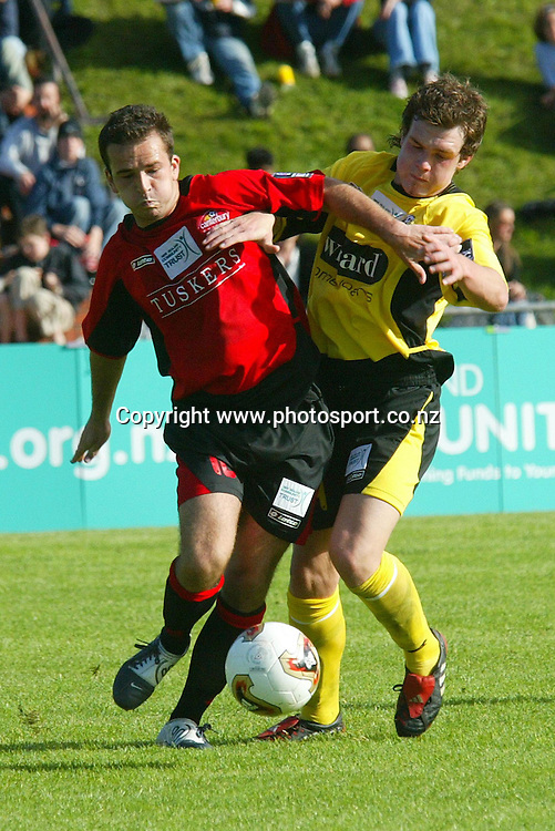 Wellington's Wayne Rooker and Canterbury's Stuart Kelly fight for possession during the 2 all draw on Newtown Park, Sunday afternoon. Soccer NZFC Round 1 17 October 2004.<br /> Photo: Marty Melville/Photosport