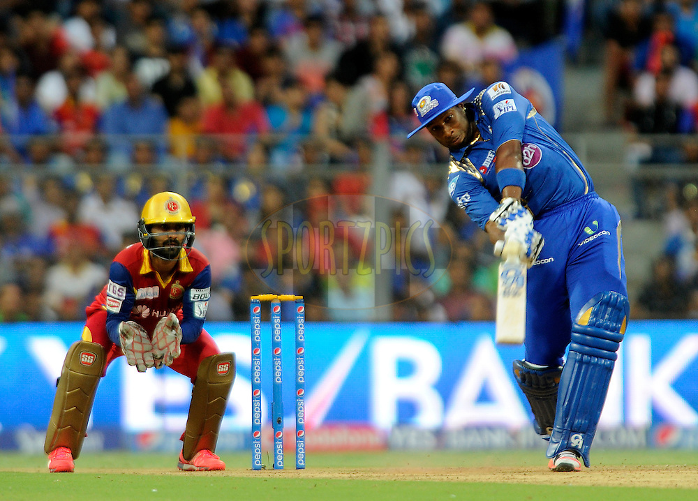 Kieron Pollard of Mumbai Indians bats during match 46 of the Pepsi IPL 2015 (Indian Premier League) between The Mumbai Indians and The Royal Challengers Bangalore held at the Wankhede Stadium in Mumbai, India on the 10th May 2015.<br /> <br /> Photo by:  Pal Pillai / SPORTZPICS / IPL