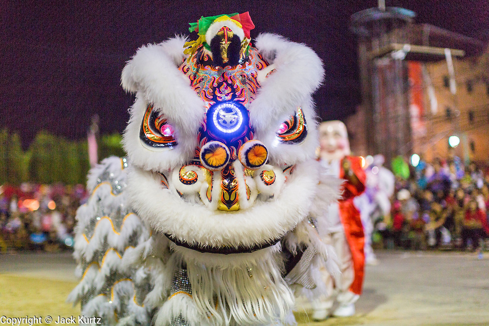 09 FEBRUARY 2014 - HAT YAI, SONGKHLA, THAILAND: A lion dance troupe performs during Lunar New Year in the Tong Sia Siang Tueng temple in Hat Yai. Hat Yai was originally settled by Chinese immigrants and still has a large ethnic Chinese population. Chinese holidays, especially Lunar New Year (Tet) and the Vegetarian Festival are important citywide holidays. Lion and dragon dances are popular during Lunar New Year festivities because they are believed to chase away the lingering malevolent spirits and provide to prosperity and good fortune.      PHOTO BY JACK KURTZ
