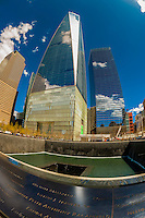 Reflecting pool, National September 11 Memorial & Museum with One World Trade Center and World Financial Center in background, New York, New York USA.