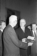 "18/06/1963.06/18/1963.18 June 1963 .Variety Club ""Gold Card"" awarded to President de Valera. Mr. Rotus Harvey, (left) International Chief Barker of Variety Club presenting the Gold Card - the organisations highest honour- to President de Valera, in recognition of the interest he has shown in fund raising activities of the Variety Club of Ireland to aid blind children. On the right of the President is Mr. Des O'Keeffe, Irish Chief Barker. The presentation was made at Aras an Uachtarain where a number of members of the club were present."