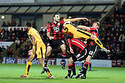 Andy Parrish and Mark Roberts battle during the Sky Bet League 2 match between Morecambe and Cambridge United at the Globe Arena, Morecambe, England on 24 November 2015. Photo by Pete Burns