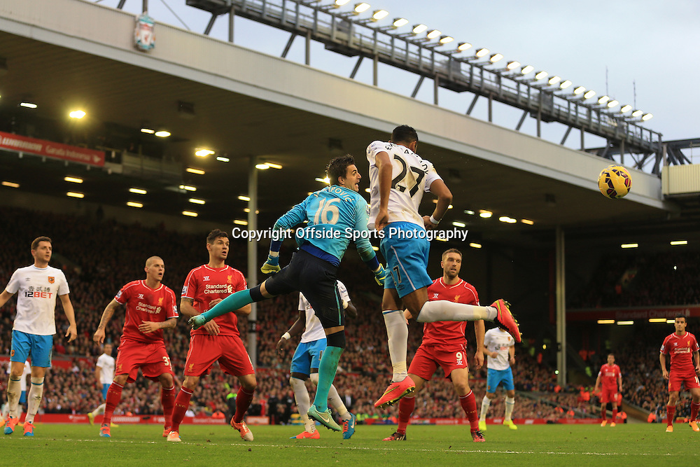 25th October 2014 - Barclays Premier League - Liverpool v Hull City - Hull goalkeeper Eldin Jakupovic punches clear from teammate Ahmed Elmohamady - Photo: Simon Stacpoole / Offside.