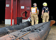 © licensed to London News Pictures. MARLOW, UK.  03/08/11. Firemen survey the damage. Marlow Rowing Club has been badly damaged by fire today (03 August 2011). Boats with an estimated value of 100,000 pounds have been damaged. Steve Redgrave, Olympic Rower, who trained at the club and is from Marlow said his daughters boat is believed to be inside.  Mandatory Credit Stephen Simpson/LNP