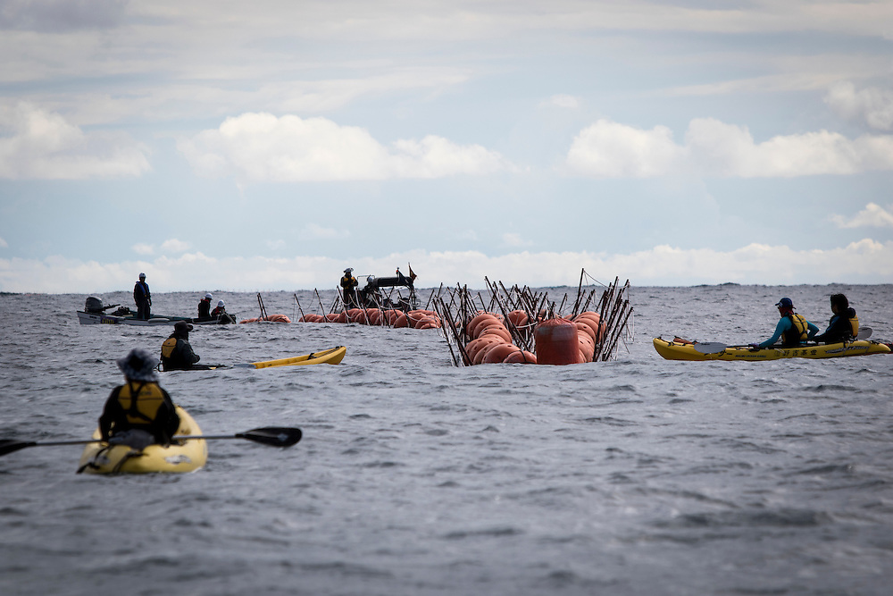 OKINAWA, JAPAN - JANUARY 19 : Anti U.S. Base protesters in motor boats and kayaks disrupt the installation of above-water fencing at the construction zone for the new rellocated U.S Marine Airbase in Oura Bay, Camp Schwab, Henoko, Nago, Okinawa Prefecture, Japan on Janaury 19, 2017. The scheduled reclamation area for new the construction totals 160 hectares and will include 2 runways. Construction of the new base will require 21 million cubic meters of soil, enough to fill the Okinawa Prefectural Office 70 times, 17 million tons of which will be hauled in from Kyushu and Shikoku. (Photo by Richard Atrero de Guzman/NURPhoto)