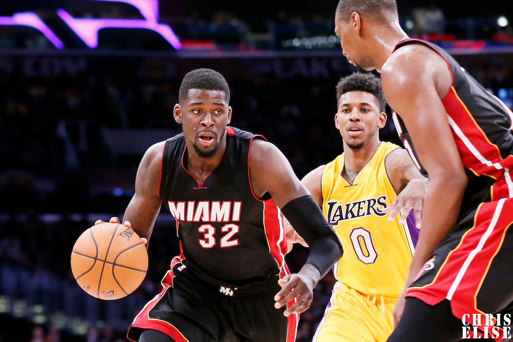 13 January 2014: Miami Heat forward James Ennis (32) drives past Los Angeles Lakers forward Nick Young (0) during the Miami Heat 78-75 victory over the Los Angeles Lakers, at the Staples Center, Los Angeles, California, USA.