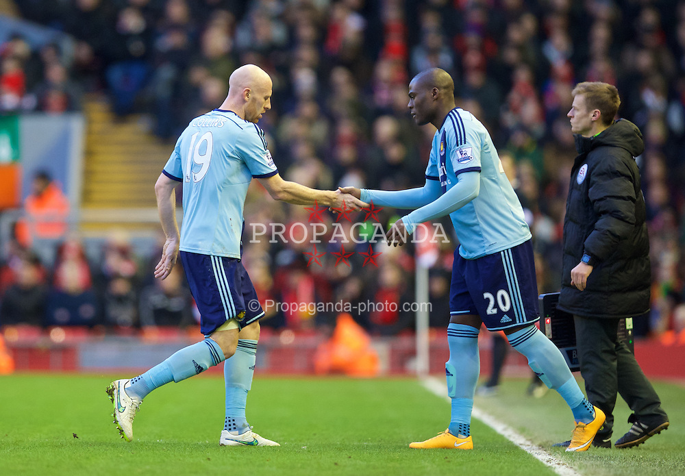 LIVERPOOL, ENGLAND - Saturday, January 31, 2015: West Ham United's James Collins is replaced by Guy Demel as he goes off injured during the Premier League match against Liverpool at Anfield. (Pic by David Rawcliffe/Propaganda)