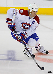 Jan 2, 2009; Newark, NJ, USA; Montreal Canadiens right wing Alexei Kovalev (27) skates with the puck during the third period at the Prudential Center.  The Devils defeated the Canadiens 4-1.