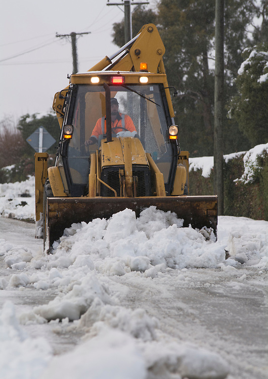 A loader clears snow at Waddington, inland Canterbury, New Zealand, Thursday, July 13, 2017. Credit:  SNPA / David Alexander -NO ARCHIVING-
