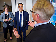 15 APRIL 2019 - DES MOINES, IOWA: JULIÁN CASTRO (center) talks to TASCHA BROWN, Director of Central Campus, (left) and CHUCK GASSMAN, from Bell Brothers Heating and Cooling, during Castro's visit the Central Campus Skilled Trades Alliance at the Des Moines Public School's Central Campus Monday. Castro is on his third visit to Iowa since declaring his candidacy for the Democratic ticket of the US Presidency. Casto talked to students and administrators about skilled trades education and toured the campus. Iowa traditionally hosts the the first selection event of the presidential election cycle. The Iowa Caucuses will be on Feb. 3, 2020.                PHOTO BY JACK KURTZ