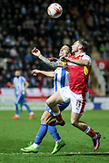 Jon Taylor (Rotherham United) and Brighton & Hove Albion winger Anthony Knockaert (11) jump for the ball during the EFL Sky Bet Championship match between Rotherham United and Brighton and Hove Albion at the AESSEAL New York Stadium, Rotherham, England on 7 March 2017. Photo by Mark P Doherty.
