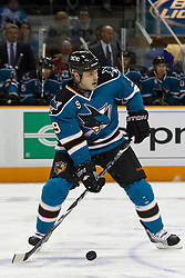 March 23, 2011; San Jose, CA, USA;  San Jose Sharks defenseman Ian White (9) passes the puck against the Calgary Flames during the first period at HP Pavilion. San Jose defeated Calgary 6-3. Mandatory Credit: Jason O. Watson / US PRESSWIRE