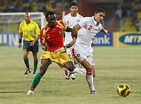 Photo: Steve Bond/Richard Lane Photography.<br /> Guinea v Morocco. Africa Cup of Nations. 24/01/2008. Pascale Feindounou (L) tussles with Michael Basser (R)