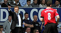 Photo: Paul Thomas.<br />Everton v Manchester United. The Barclays Premiership. 28/04/2007.<br /><br />David Moyes, manager of Everton and old Everton player (Now Utd) Wayne Rooney during the game.