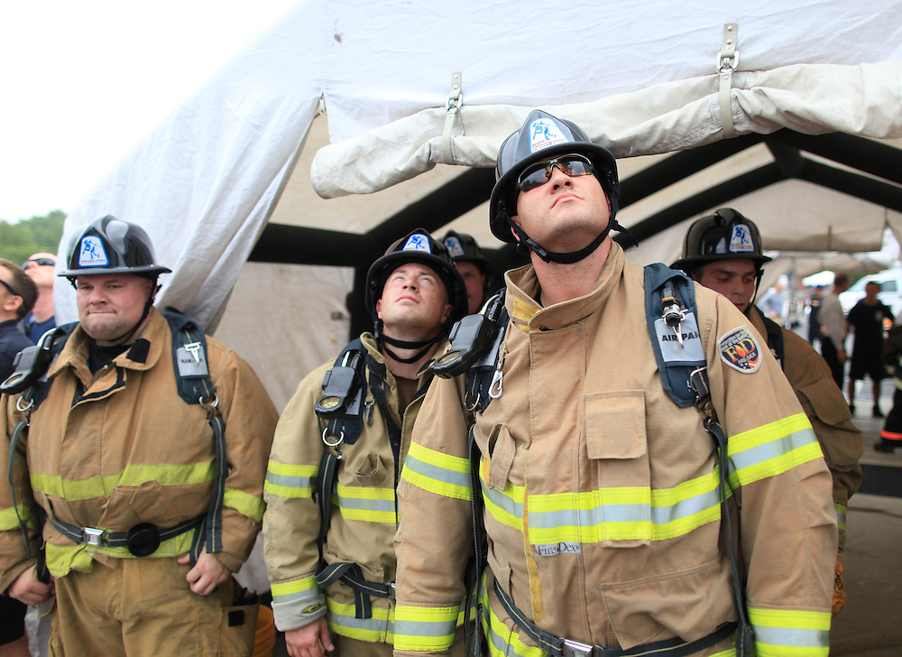 Firefighters watch teams compete in the Scott Firefighter Combat Challenge in Fishers August 4, 2012. The challenge promotes and showcases the talents, skills, and athleticism of America's firefighters. ..Photo by Chris Bergin