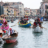 VENICE, ITALY - FEBRUARY 16:  Rowers dresses with  costumes take part in the traditional regatta on the Grand Canal which officially opens the Carnival  on February 16, 2014 in Venice, Italy. The 2014 Carnival of Venice will run from February 15 to March 4 and includes a program of gala dinners, parades, dances, masked balls and music events.  (Photo by Marco Secchi/Getty Images)