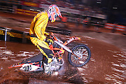 Eventual winner David Knight #101 jumps a log obstacle buried in the water pit during his heat race at the 2007 Maxxis AMA Endurocross at the Lazy E Arena in Guthrie, Oklahoma.  Event was won by David Knight #101 on KTM