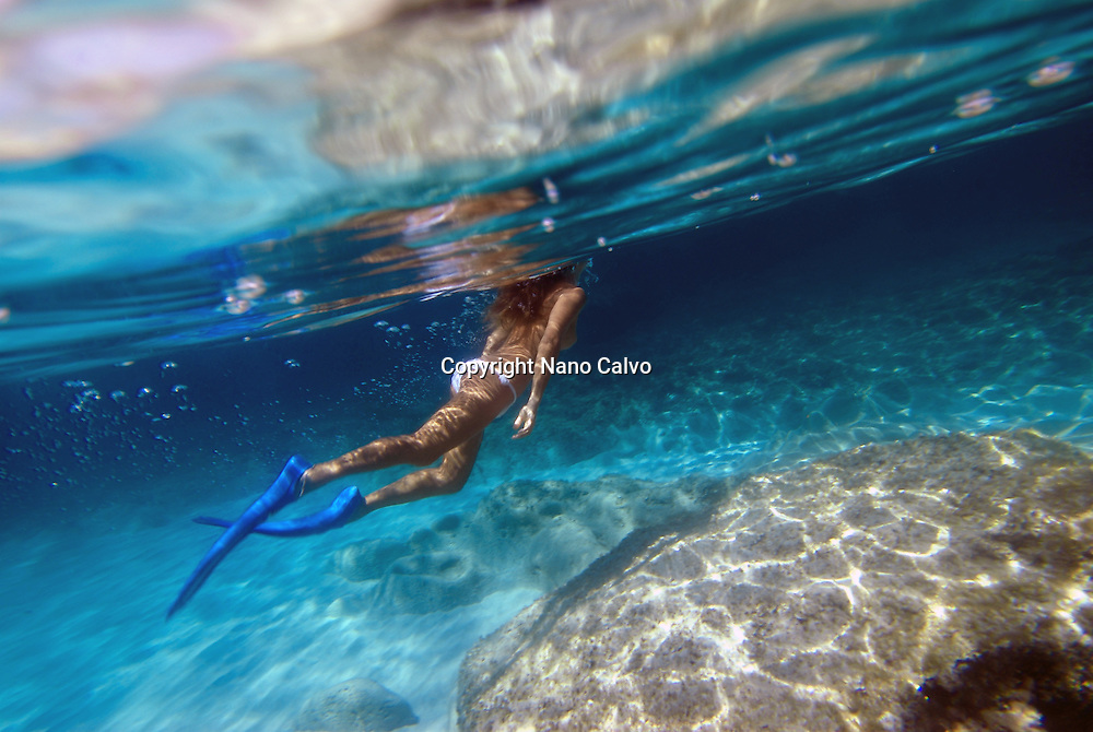 Attractive woman swimming underwater in Formentera, Balearic Islands, Spain