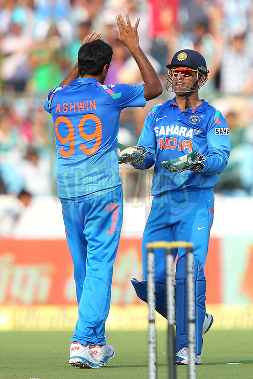 MS Dhoni (capt & wk) of India celebrates the wicket of Phillip Hughes of Australia (Not pictured) with Ravichandran Ashwin of India during the 2nd One Day International (ODI) match in the Star Sports Series between India and Australia held at the Sawai Mansingh Stadium in Jaipur on the 16th October 2013<br /> <br /> Photo by Ron Gaunt-BCCI-SPORTZPICS<br /> <br /> Use of this image is subject to the terms and conditions as outlined by the BCCI. These terms can be found by following this link:<br /> <br /> http://sportzpics.photoshelter.com/gallery/BCCI-Image-terms-and-conditions/G00004IIt7eWyCv4/C0000ubZaQCkIRgQ