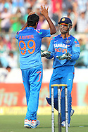 MS Dhoni (capt &amp; wk) of India celebrates the wicket of Phillip Hughes of Australia (Not pictured) with Ravichandran Ashwin of India during the 2nd One Day International (ODI) match in the Star Sports Series between India and Australia held at the Sawai Mansingh Stadium in Jaipur on the 16th October 2013<br /> <br /> Photo by Ron Gaunt-BCCI-SPORTZPICS<br /> <br /> Use of this image is subject to the terms and conditions as outlined by the BCCI. These terms can be found by following this link:<br /> <br /> http://sportzpics.photoshelter.com/gallery/BCCI-Image-terms-and-conditions/G00004IIt7eWyCv4/C0000ubZaQCkIRgQ