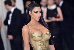 Kim Kardashian walking the red carpet at The Metropolitan Museum of Art Costume Institute Benefit celebrating the opening of Heavenly Bodies : Fashion and the Catholic Imagination held at The Metropolitan Museum of Art  in New York, NY, on May 7, 2018. (Photo by Anthony Behar/Sipa USA)