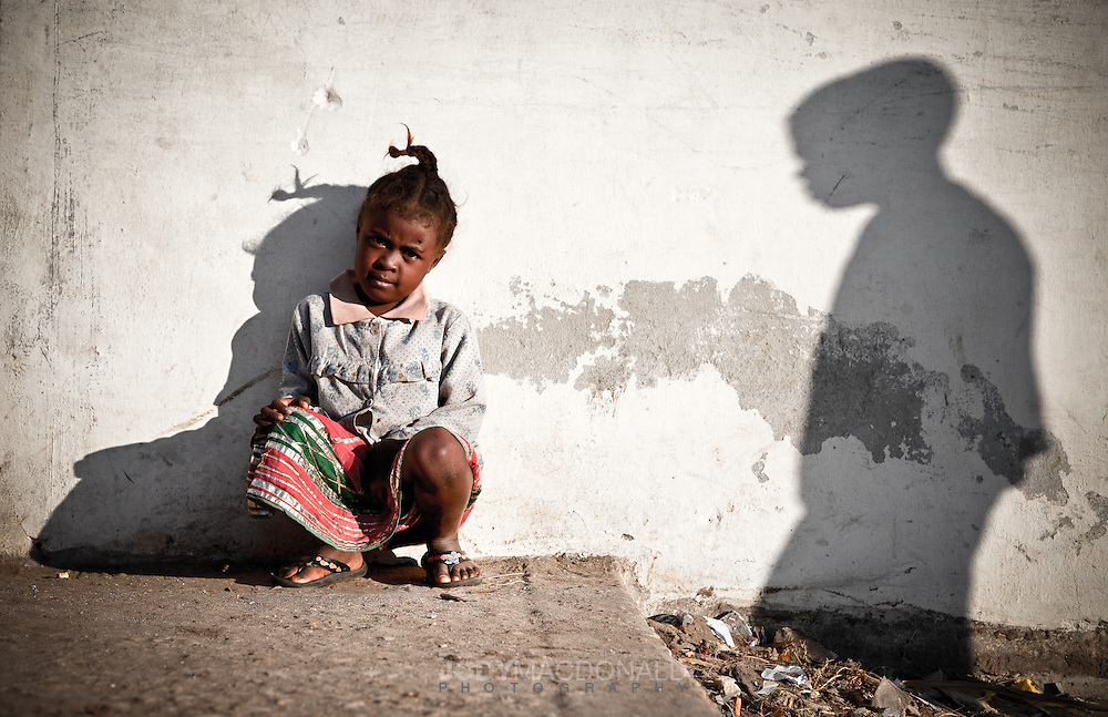 Child with shadow on the wall in Morondova, Madagascar
