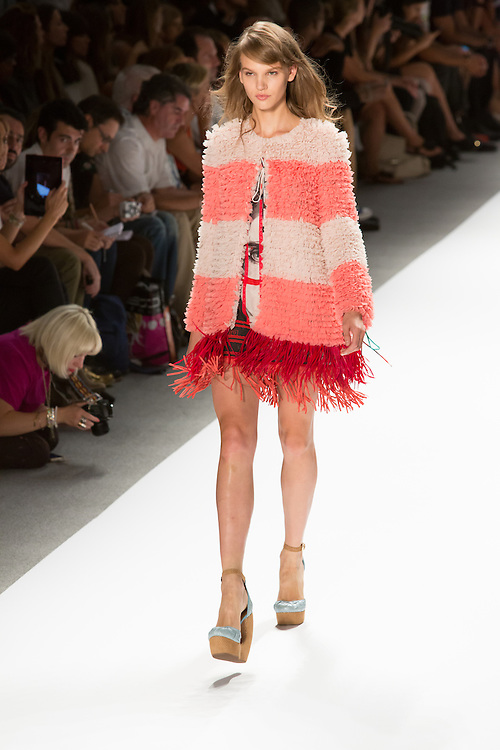 Soft orange and white vest with red fringe. By Custo Barcelona at the Spring 2013 Fashion Week show in New York.