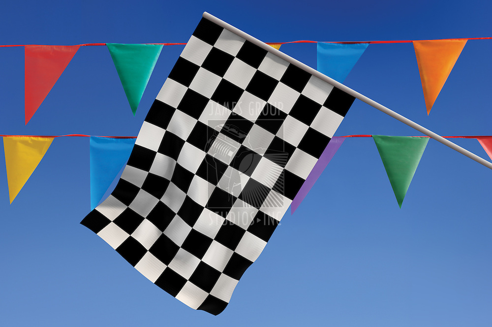 Checkered flag against a blue sky with colorful penants