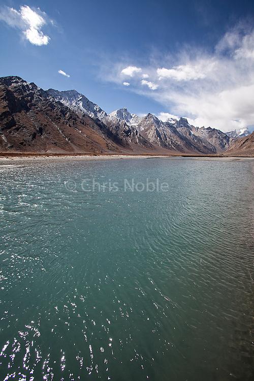 An alpine lake beneath the Greater Himalaya Range on the way into the Zanskar Valley over the Penzi La Pass.