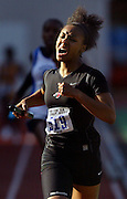 05/14/2009 - Lincoln's Tiarra Pittman (519) gives her all on the way to completing the final leg of the women's 4x400 meter relay race.The 6A PIL Varsity District Track Meet takes place at Lewis and Clark College....KEYWORDS:  City, Portland, sports, high school, state, boys, girls