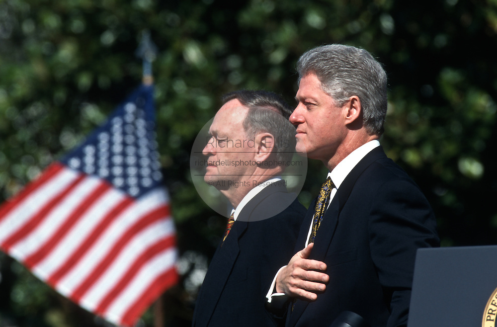 President Bill Clinton stands for the national anthem with visiting Canadian Prime Minister Jean Chrétien during formal arrival ceremonies April 8, 1997 on the South Lawn of the White House.