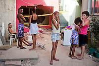 Residents of Largo do Tanque undergo forced evictions and demolition of homes in Rio de Janeiro&rsquo;s West Zone, to make room for the Transcarioca Highway, that will eventually be built to accommodate the Olympics, in Rio de Janeiro, Brazil, on Monday, Feb. 25, 2013. <br /> <br /> In less than 2 weeks, 54 houses were demolished with sledgehammers and bulldozers. In under 2 weeks, 54 houses were demolished and hundreds of residents left to fend for themselves. The City assessor sent to handle negotiations told residents not to speak with one another or seek legal advice otherwise he would reduce settlement offers. Many residents agreed to compensations, around R$7000 (US$3500). Most residents cannot afford to buy a plot of land with that compensation and will be forced to rent kitchenettes, at less than 20m2. As established in the Brazilian Constitution, and in accordance with local legislation (the Organic Municipal Law), the duration of residents&rsquo; life in the area gave them legal rights to the homes, while compensation should allow them to attain an equal situation elsewhere. <br /> <br /> The west zone, located west of downtown and beach neighborhoods is often overlooked and is widely known to be run by militia groups, who are former and current police and firefighter personnel that run extortion rings to monopolies.