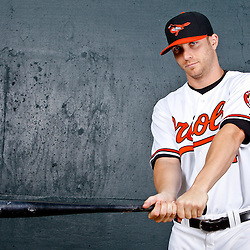 February 26, 2011; Sarasota, FL, USA; Baltimore Orioles left fielder Nolan Reimold (14) poses during photo day at Ed Smith Stadium.  Mandatory Credit: Derick E. Hingle