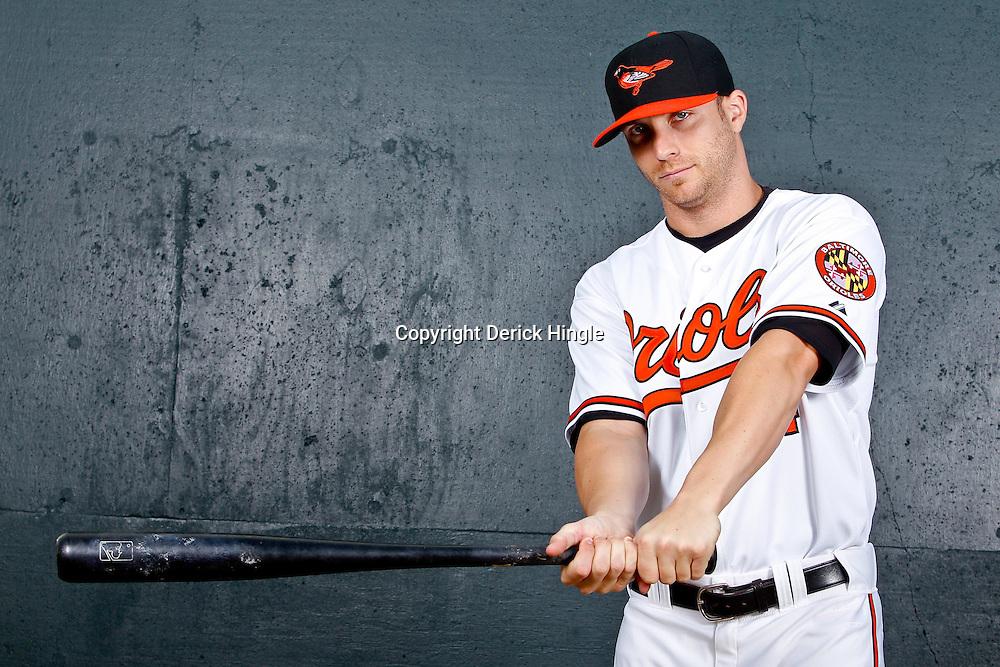 February 26, 2011; Sarasota, FL, USA; Baltimore Orioles left fielder Nolan Reimold (14) poses during photo day at Ed Smith Stadium.  Mandatory Credit: Derick E. Hingle