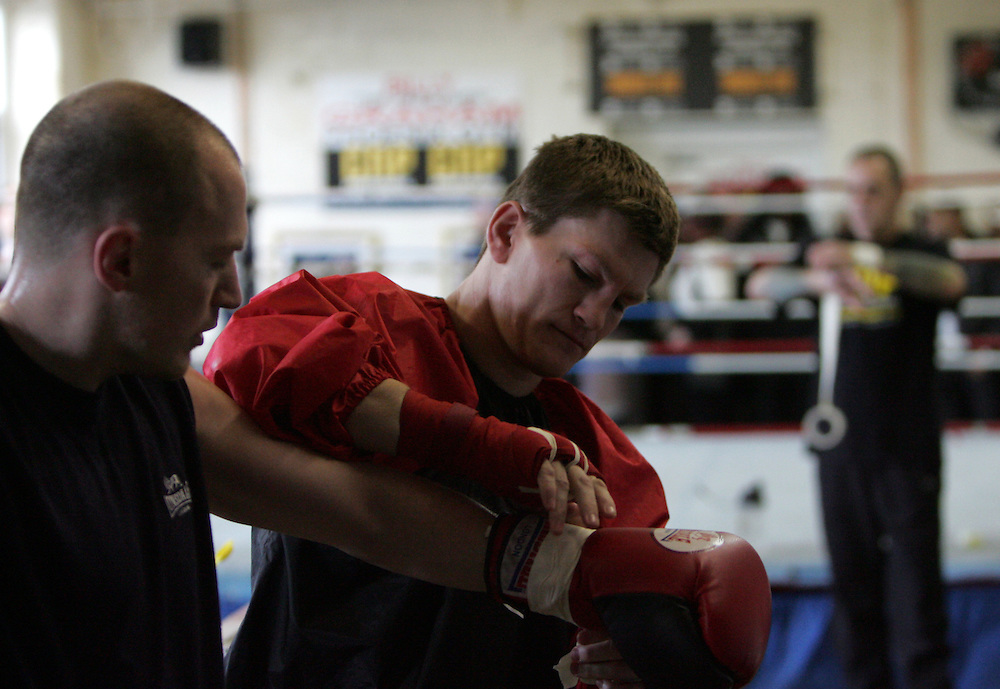 Ricky Hatton laces his brothers (Matthew Hatton) gloves up as prepares for his upcoming WBC Welterweight World title fight in Las Vegas on December 8th 2007 against Floyd Mayweather. 29th October 2007, Denton, Manchester.....** Exclusive images - Minimum usage fees apply