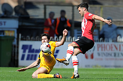 Southend United's Michael Timlin is tackled by Exeter City's Jimmy Keohane - Photo mandatory by-line: Harry Trump/JMP - Mobile: 07966 386802 - 18/04/15 - SPORT - FOOTBALL - Sky Bet League Two - Exeter City v Southend United - St James Park, Exeter, England.