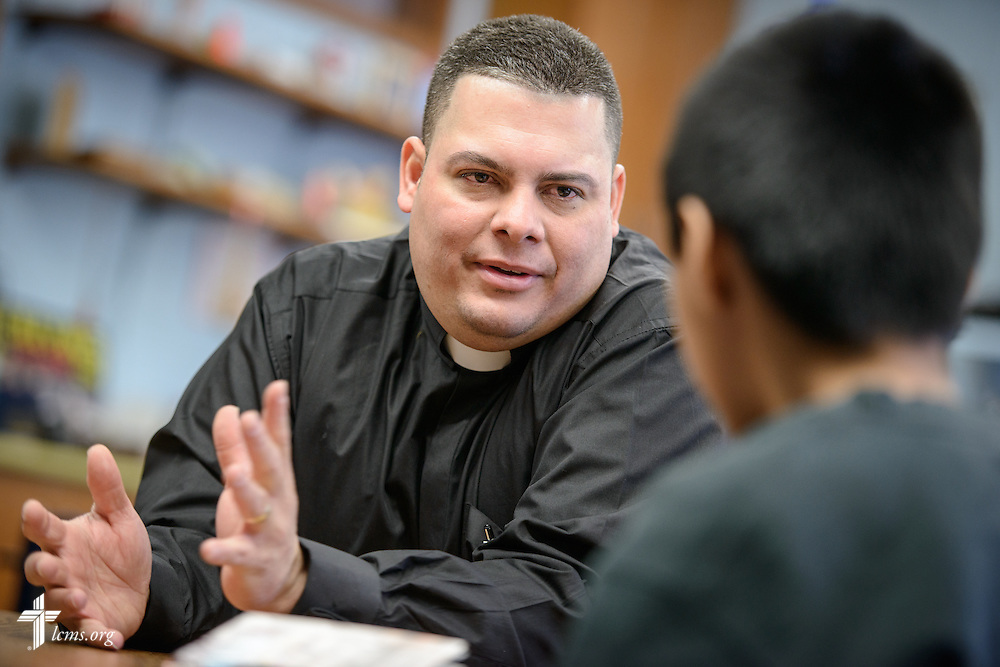 Vicar David Blas, missionary-at-large at LCMS Sheboygan County Hispanic Outreach and St. John's Lutheran Church of Plymouth, Wis., mentors Jose Vazquez and Gustavo Lozano (not pictured) on Friday, Jan. 29, 2016, at Immanuel Evangelical Lutheran School in Sheboygan, Wis. LCMS Communications/Erik M. Lunsford