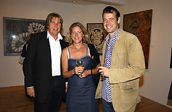 Left to right, THEO FENNELL, ROSIE GERRARD-WRIGHT and her brother LANCE GERRARD-WRIGHT at a private view of artist Adam Bricusse's paintings entitles 'The Mysteries Within' held at the Charing X Gallery, 121-125 Charing Cross Road, London WC2 on 12th September 2006.<br /><br />NON EXCLUSIVE - WORLD RIGHTS