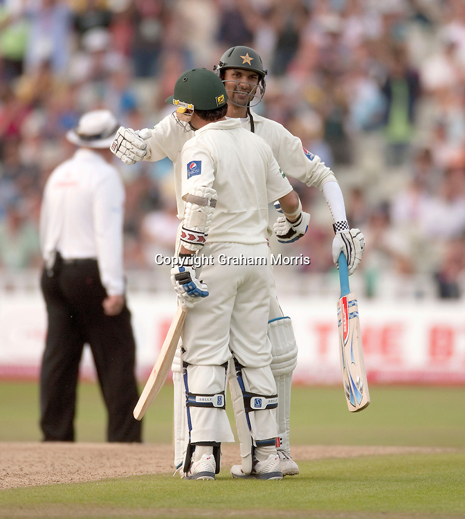 Zulqarnain Haider celebrates the hundred partnership with Saeed Ajmal (back view) during the second npower Test Match between England and Pakistan at Edgbaston, Birmingham.  Photo: Graham Morris (Tel: +44(0)20 8969 4192 Email: sales@cricketpix.com) 08/08/10