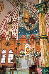 Zarcero, Alajuela, Central Highlands:  The Iglesia de San Rafael, known as the pink and white church, was built in 1895 with an exterior of metal siding and a painted interior of faux bois and marble.  It is one of the most beautiful painted churches in the world.