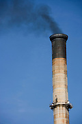 a smoke stack with black smoke
