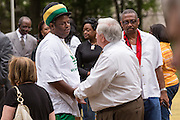 North Charleston Mayor Keith Summey greet citizens before a peace vigil on the spot where unarmed motorist Walter Scott was gunned down by police April 12, 2015 in North Charleston, South Carolina. About 100 people showed up for the brief vigil following a healing service at Charity Mission Baptist Church.
