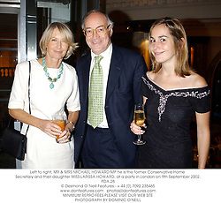 Left to right, MR & MRS MICHAEL HOWARD MP he is the former Conservative Home Secretary and their daughter MISS LARISSA HOWARD, at a party in London on 9th September 2002.	PDA 28