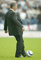 Photo: Aidan Ellis.<br /> Wigan Athletic v Newcastle United. The Barclays Premiership. 15/10/2005.<br /> Newcastle manager Graeme Souness goes onto the pitch to kick the ball to try to hurry his team up